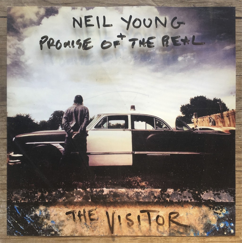 "This cover image released by Reprise Records shows,""The Visitor,"" the latest release by Neil Young. (Reprise Records via AP)"