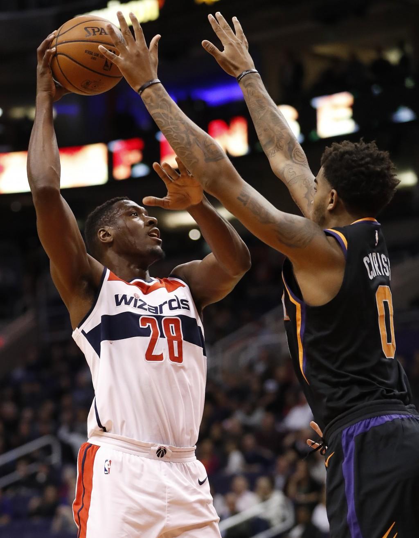 Washington Wizards center Ian Mahinmi (28) shoots over Phoenix Suns forward Marquese Chriss (0) during the first half of an NBA basketball game, Thurs