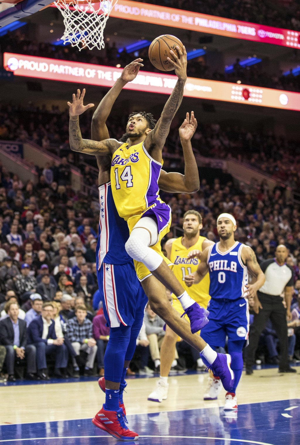 Los Angeles Lakers Brandon Ingram (14) goes up to shoot against Philadelphia 76ers Joel Embiid, of Cameroon, during the first half of an NBA basketbal