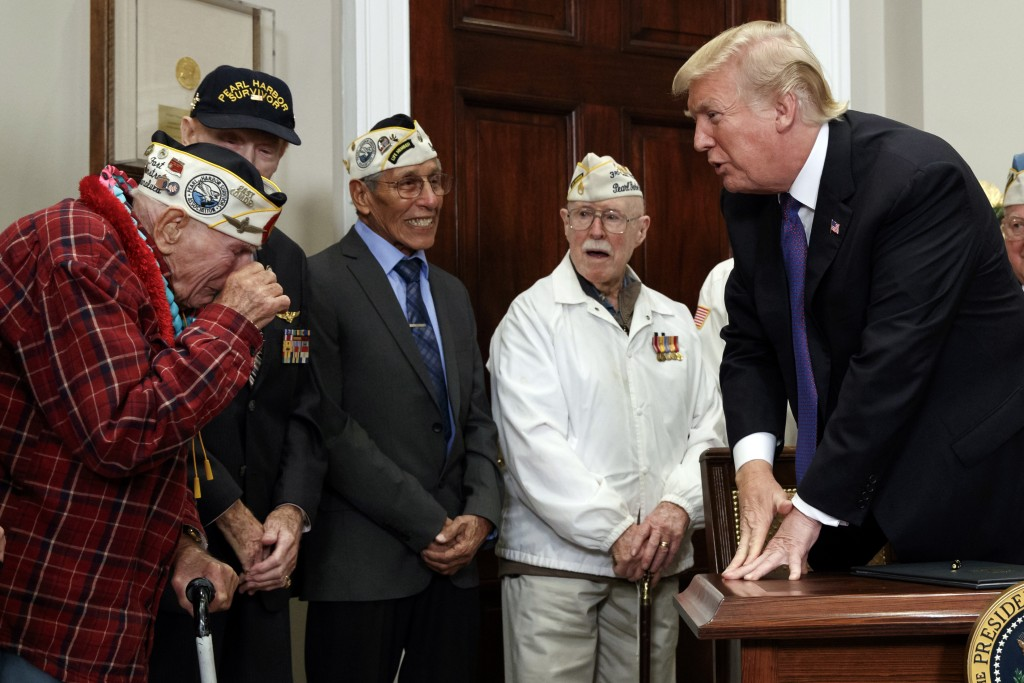 Lawrence Parry, left, wipes away a tear as he meets President Donald Trump during an event with Pearl Harbor survivors in the Roosevelt Room of the Wh