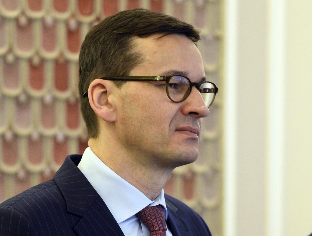 In this Dec. 5, 2017 photo Poland's Finance Minister, Mateusz Morawiecki, attends a cabinet meeting in Warsaw, Poland. Poland's conservative ruling pa