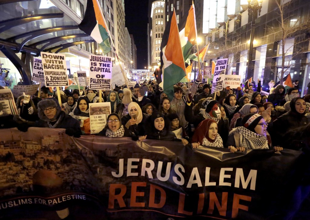 Protesters march through the streets of Chicago's famed Loop to protest President Trump's announcement declaring U.S. support for Jerusalem as the cap