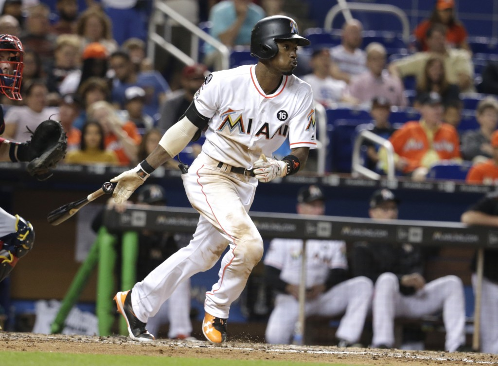 FILE - In this Sept. 30, 2017, file photo, Miami Marlins' Dee Gordon hits a single during the fifth inning of a baseball game against the Atlanta Brav