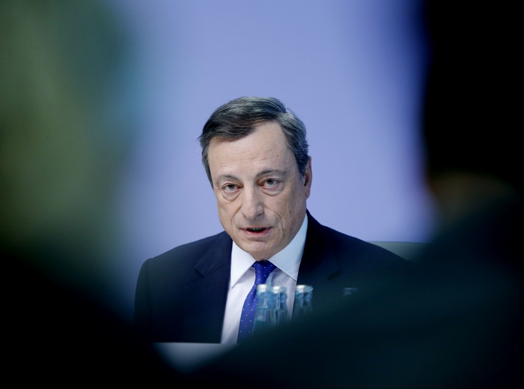 FILE - In this Thursday, April 27, 2017 file photo, the President of the European Central Bank Mario Draghi speaks during a news conference in Frankfu