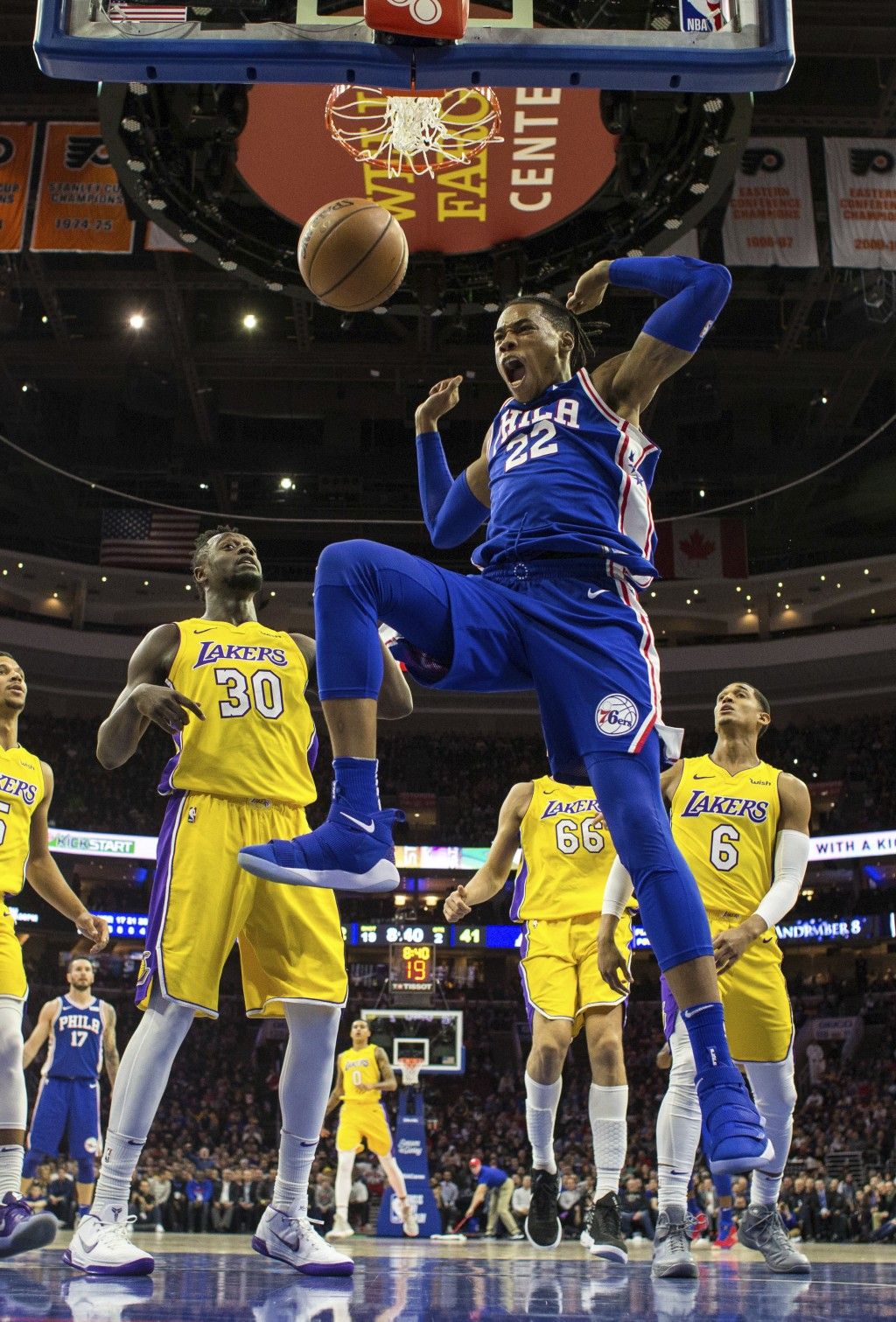 Philadelphia 76ers Richaun Holmes, front right, reacts to his dunk as Los Angeles Lakers Julius Randle, left, looks on during the first half of an NBA