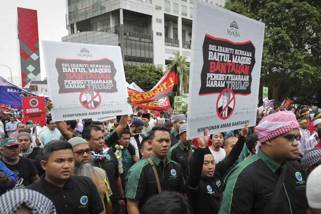 Muslims march to the U.S. Embassy during a protest in Kuala Lumpur, Malaysia, Friday, Dec. 8, 2017. Malaysian Muslims, including members of the ruling