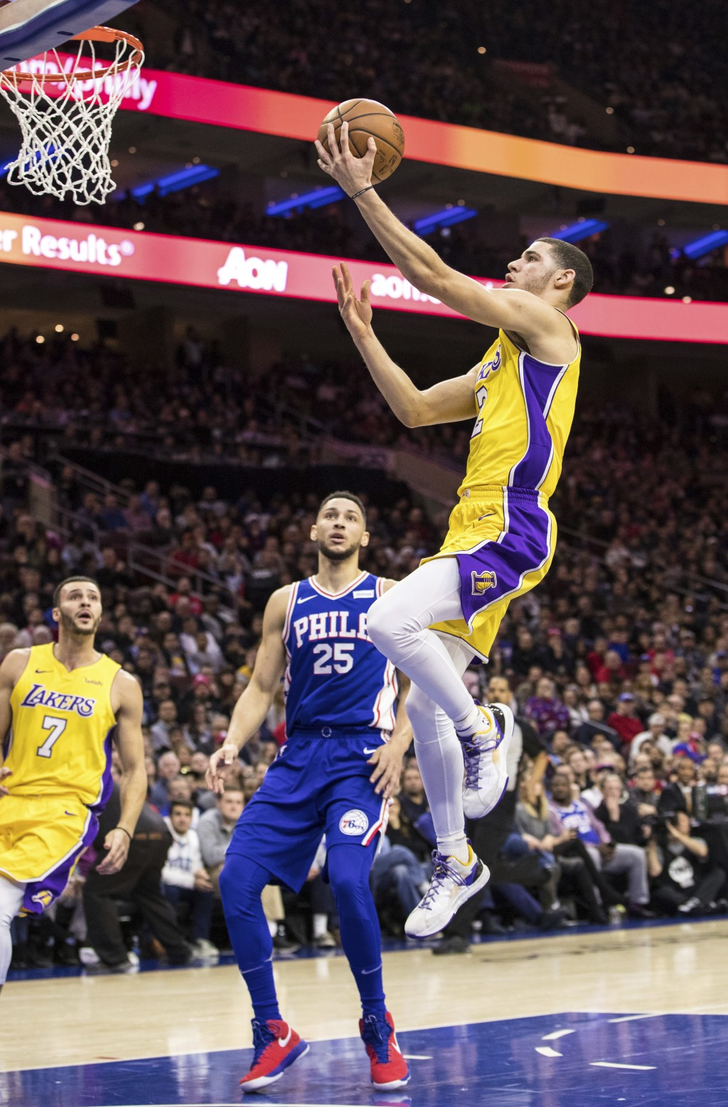 Los Angeles Lakers Lonzo Ball, right, goes up to shoot as Philadelphia 76ers Ben Simmons, left, of Australia, looks on during the first half of an NBA