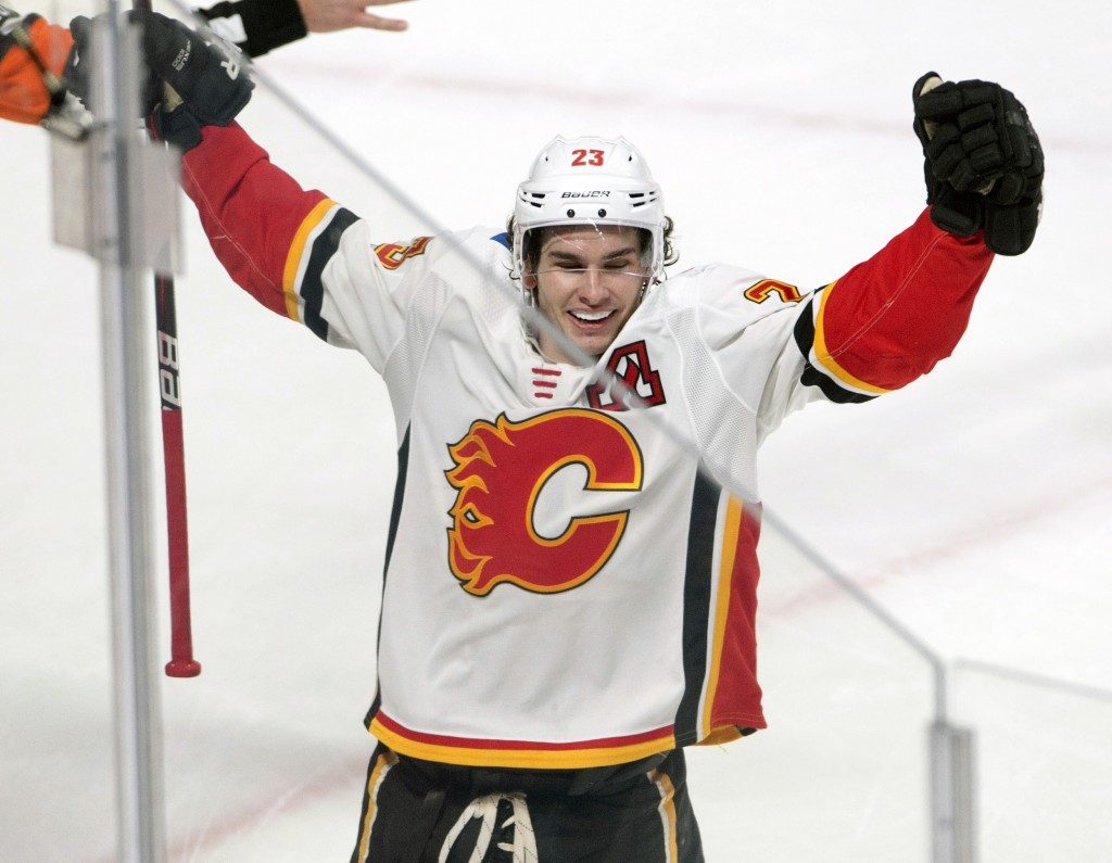 Calgary Flames center Sean Monahan (23) celebrates after scoring the winning goal against the Montreal Canadiens during overtime NHL hockey game actio