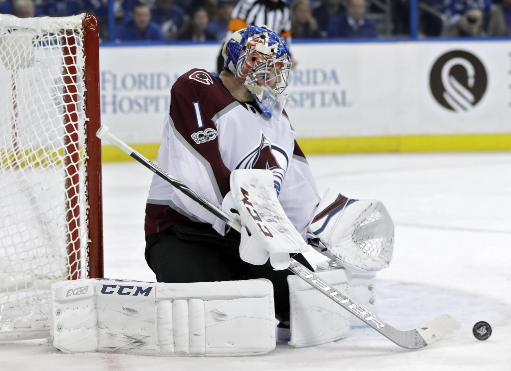 Colorado Avalanche goalie Semyon Varlamov makes a pad save on a shot by the Tampa Bay Lightning during the second period of an NHL hockey game Thursda