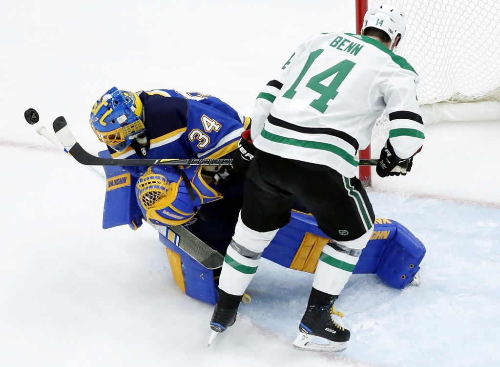St. Louis Blues goalie Jake Allen (34) watches the puck along side Dallas Stars' Jamie Benn (14) during the second period of an NHL hockey game Thursd
