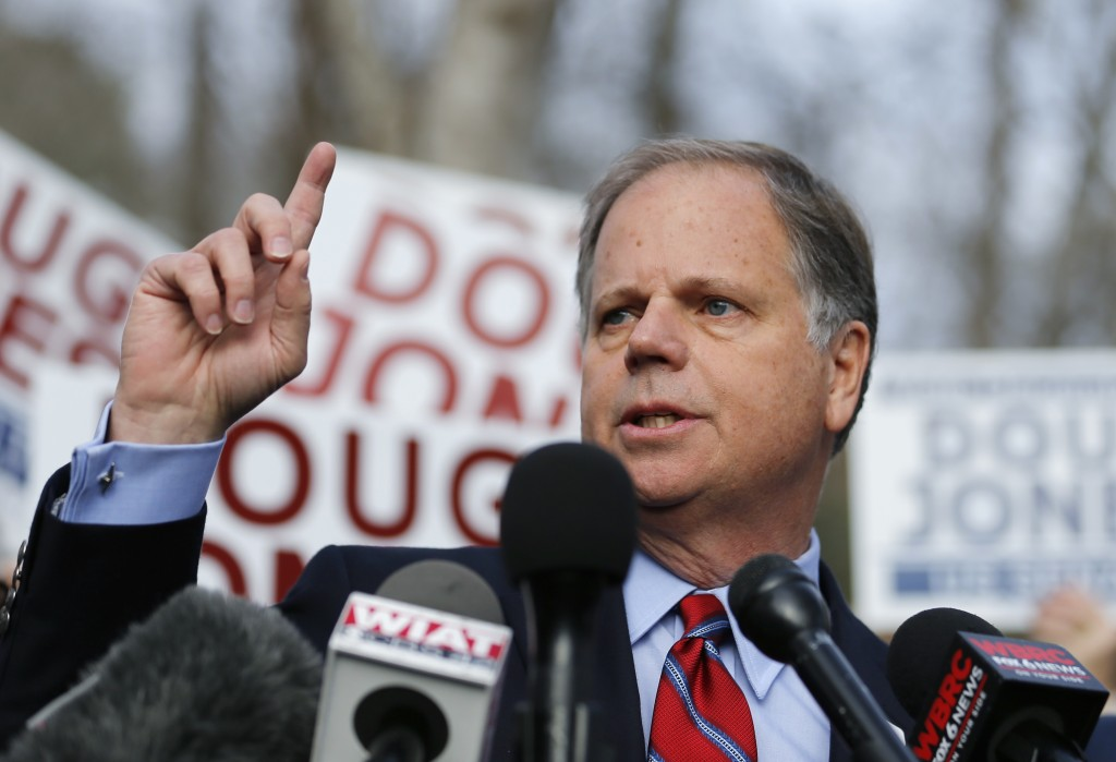 Democratic candidate for U.S. Senate Doug Jones speaks to reporters after casting his ballot Tuesday, Dec. 12, 2017, in Mountain Brook , Ala.  Jones i