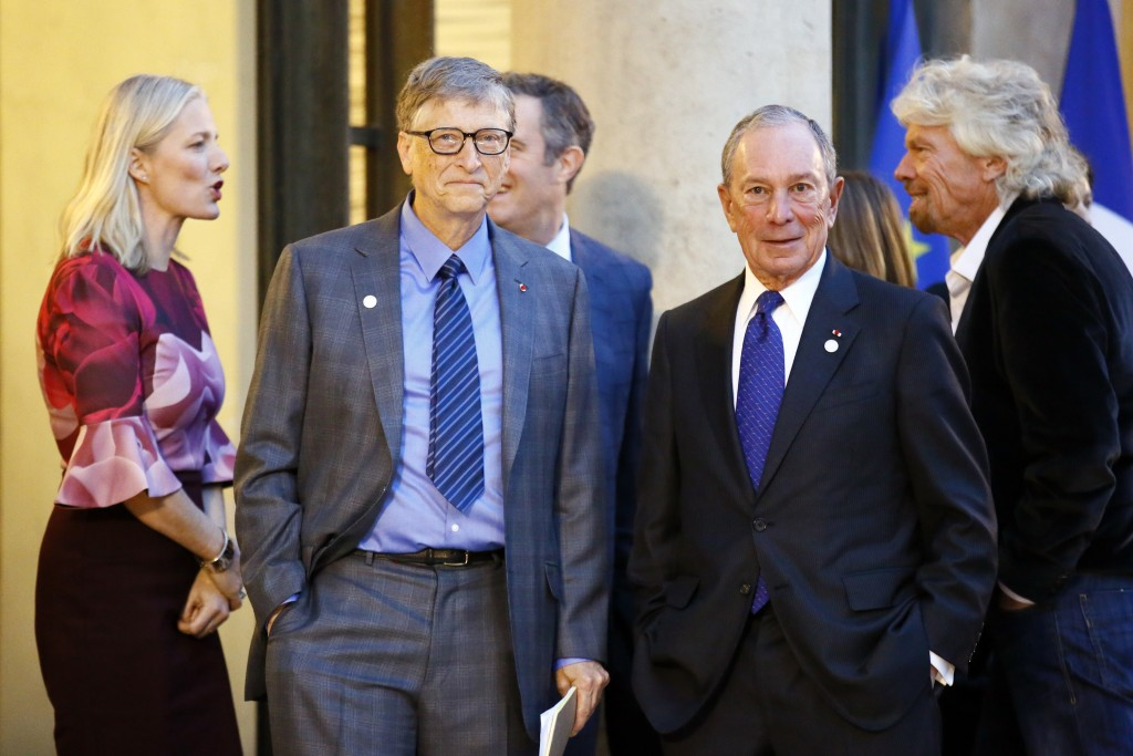 Microsoft co-founder Bill Gates, center, Sir Richard Branson, right, and special envoy to the U.N. for climate change Michael Bloomberg, second right,