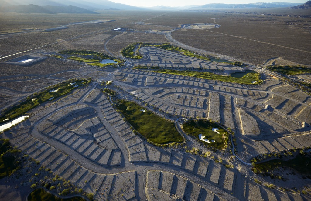 In this June 16, 2016, photo, shrubs grow on empty housing pads at the Coyote Springs golf course in the Coyote Springs development about 50 miles nor...