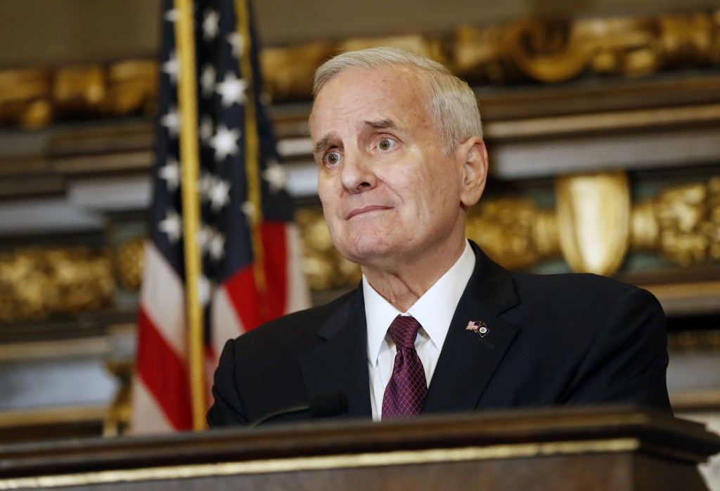 FILE- In this April 7, 2017, file photo, Minnesota Gov. Mark Dayton listens to a question from the media Friday, April 7, 2017, in St. Paul, Minn. Day...