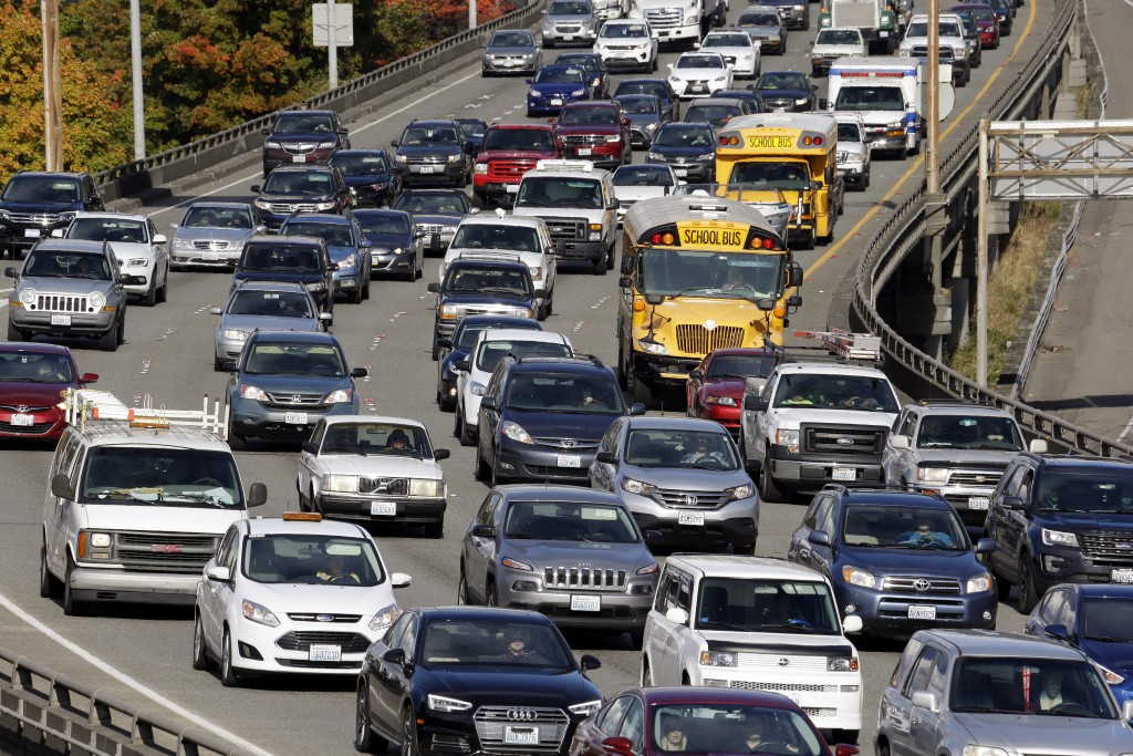 FILE - In this Wednesday, Oct. 11, 2017, file photo, traffic fills all lanes of Interstate 5 heading into downtown Seattle. Housing prices have soared...