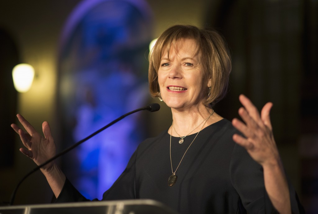 FILE - In this Jan. 10, 2015 file photo, Minnesota Democratic Lt. Gov. Tina Smith speaks to attendees at the North Star Ball in St. Paul, Minn. Minnes...