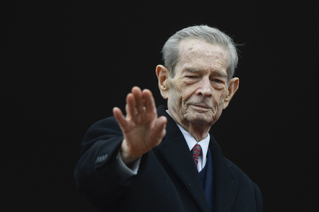 FILE - In this Wednesday, Nov. 19, 2014 file picture, Romania's former King Michael waves to supporters during an appearance at the Elisabeta Palace i...