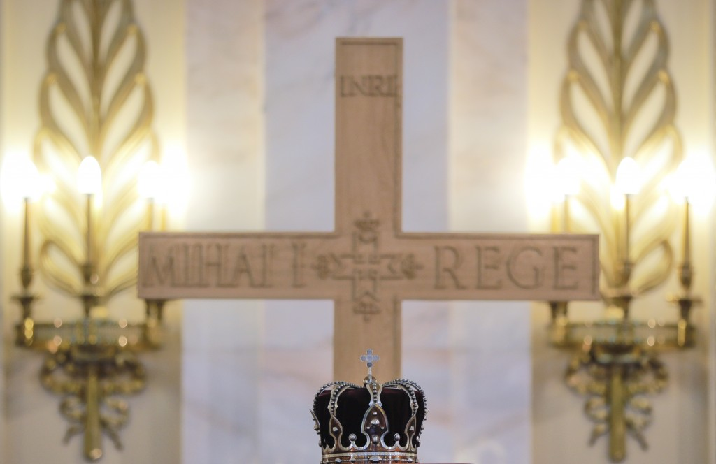 The royal crown is placed on the coffin of late Romanian King Michael, at the former royal palace, in Bucharest, Romania, Friday, Dec. 15, 2017. Thous...