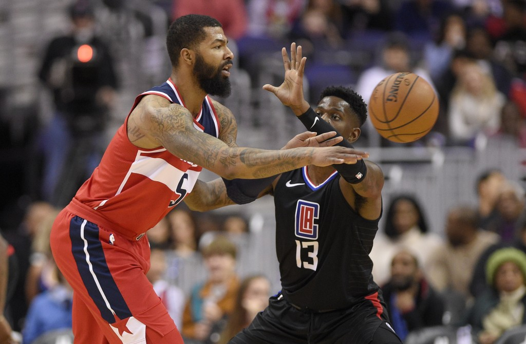 Washington Wizards forward Markieff Morris (5) passes the ball against Los Angeles Clippers forward Jamil Wilson (13) during the first half of an NBA ...