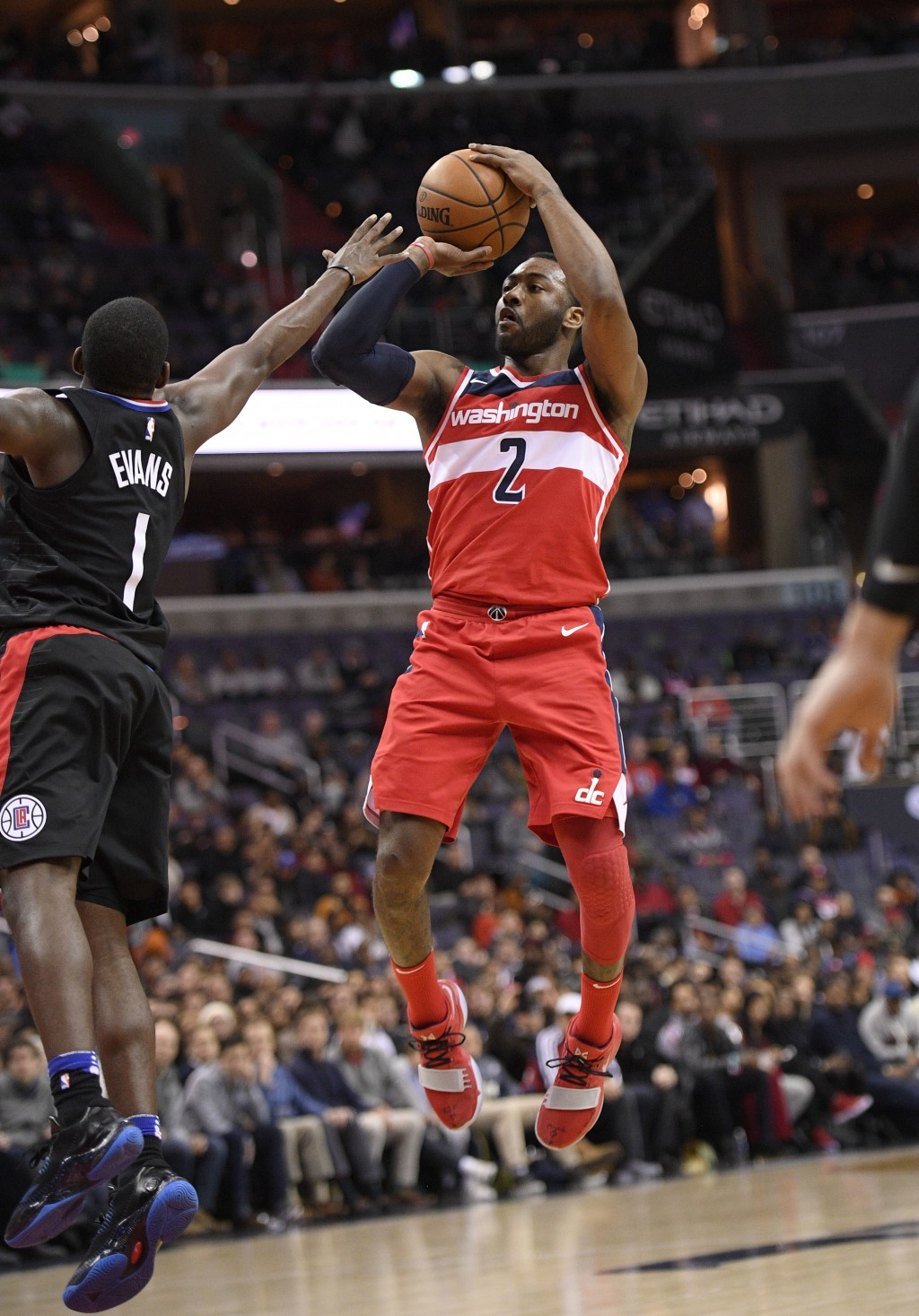 Washington Wizards guard John Wall (2) shoots against Los Angeles Clippers guard Jawun Evans (1) during the second half of an NBA basketball game, Fri...