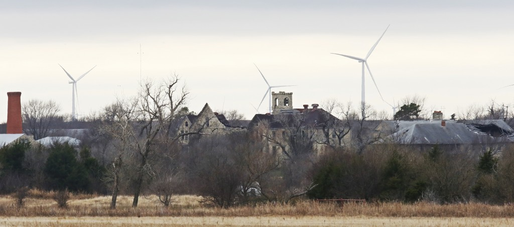 FILE - In this Wednesday, Nov. 29, 2017 file photo, buildings at the abandoned Chilocco Indian School campus are pictured in Newkirk, Okla, Five Ameri...