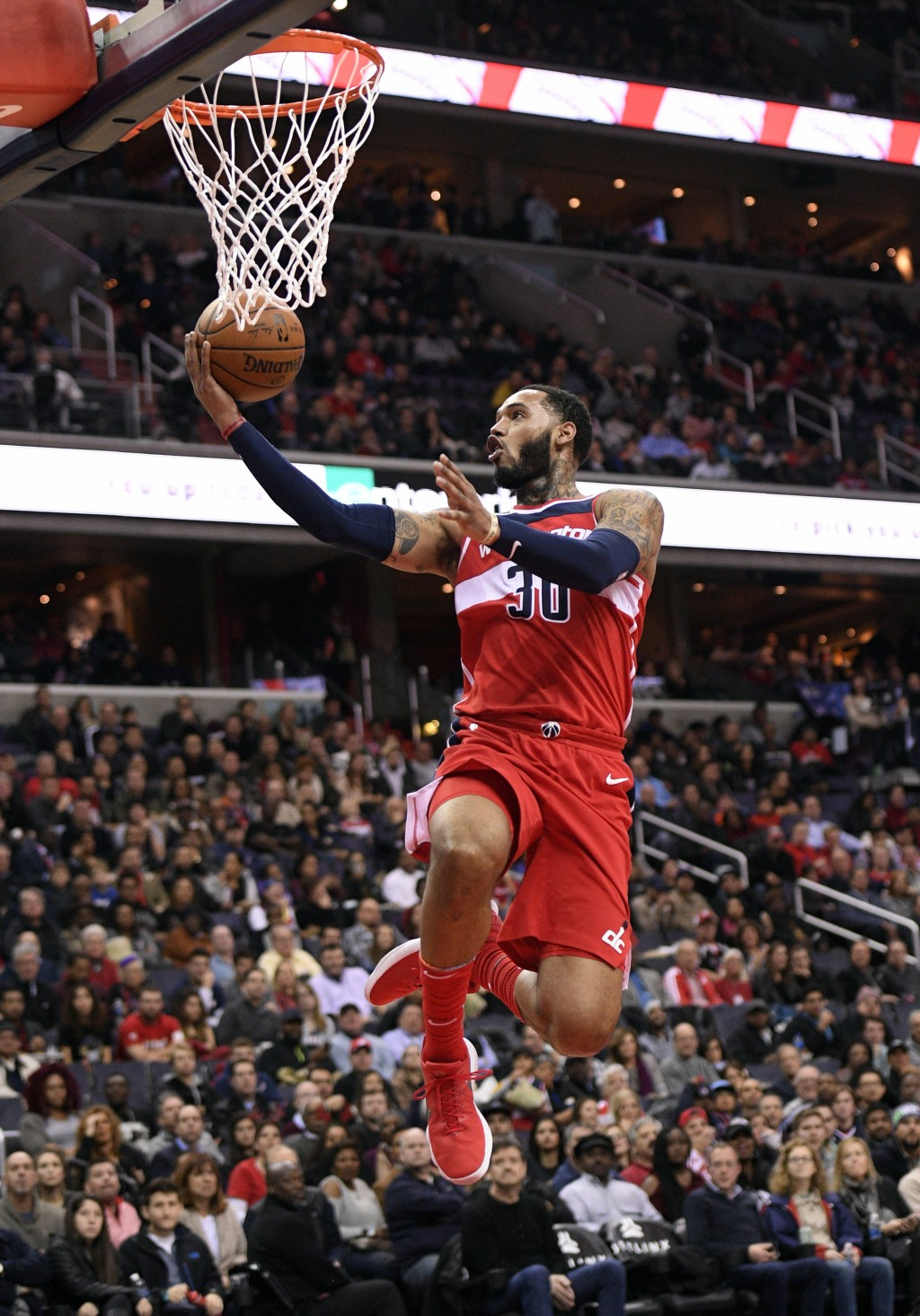 Washington Wizards forward Mike Scott (30) goes to the basket during the second half of an NBA basketball game against the Los Angeles Clippers, Frida...