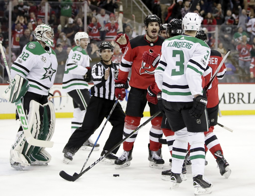 New Jersey Devils center Brian Boyle, center, shouts at Dallas Stars defenseman John Klingberg (3), of Sweden, during an argument moments after Boyle