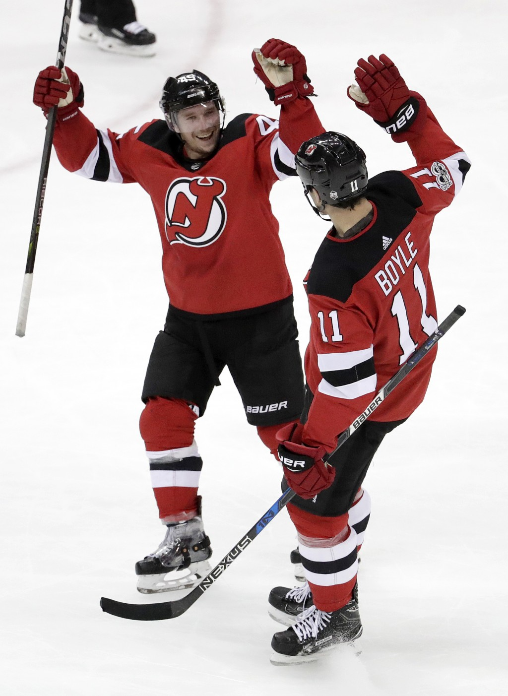 New Jersey Devils center Brian Boyle (11) and defenseman Sami Vatanen (45), of Finland, celebrate Boyle's open-net goal during the third period of an