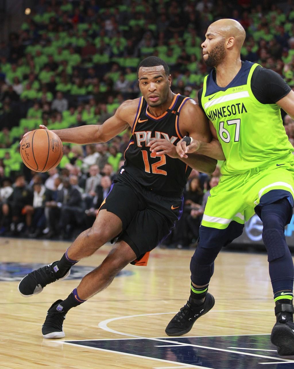 Phoenix Suns forward T.J. Warren (12) drives against Minnesota Timberwolves center Taj Gibson (67) in the first quarter of an NBA basketball game on S...
