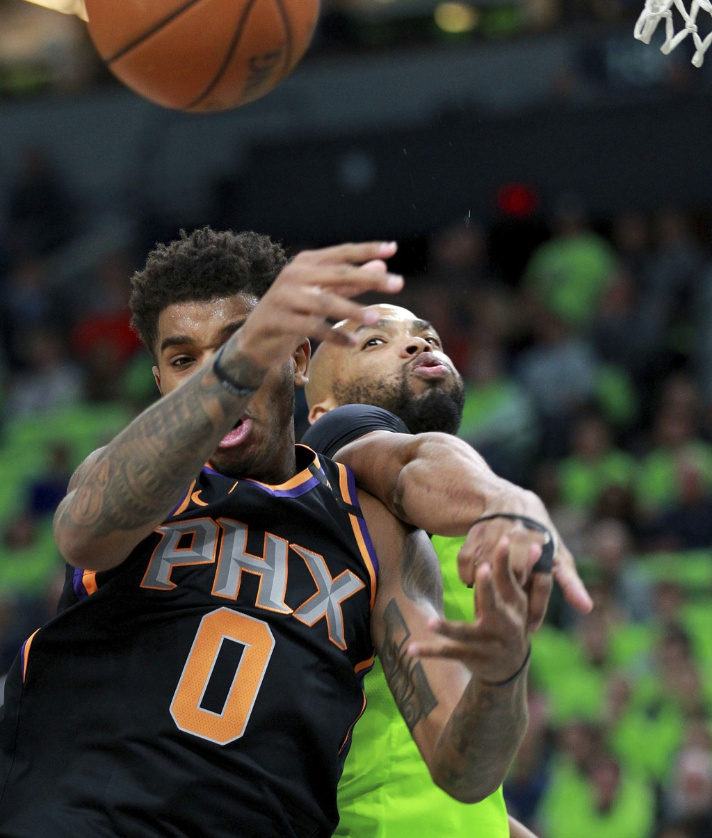 Phoenix Suns forward Marquese Chriss (0) and Minnesota Timberwolves center Taj Gibson (67) fight for a rebound in the first quarter of an NBA basketba...