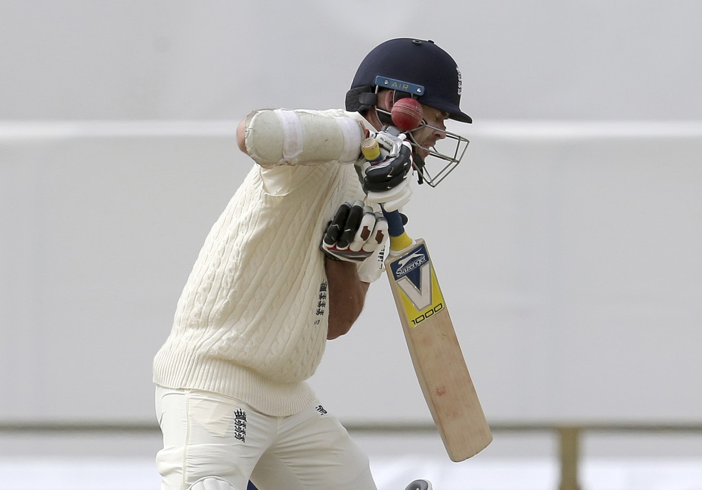 England's James Anderson is hit on the helmet by Australia's Pat Cummins during the final day of their Ashes cricket test match in Perth, Australia, M...