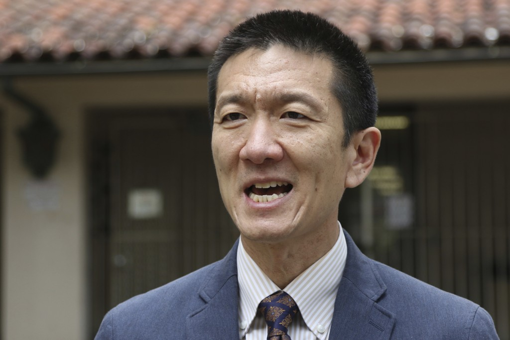 FILE - In this Oct. 17, 2017, file photo, Hawaii Attorney General Douglas Chin speaks to The Associated Press about Hawaii's lawsuit challenging Presi...