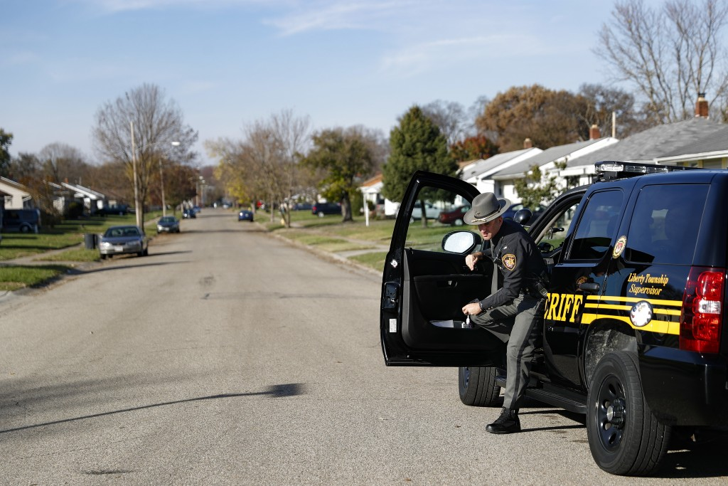 In this Nov. 14, 2017, photo, Lieutenant Morgan Dallman, of the Butler County Sheriff's Office, exits his vehicle in the Cherokee Park neighborhood of...