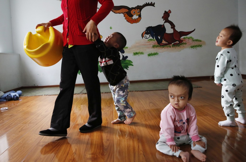 Children rest and play at a foster home of the New Hope Foundation on the outskirts of Beijing, China, on Wednesday, Oct. 11, 2017. The charity provid...