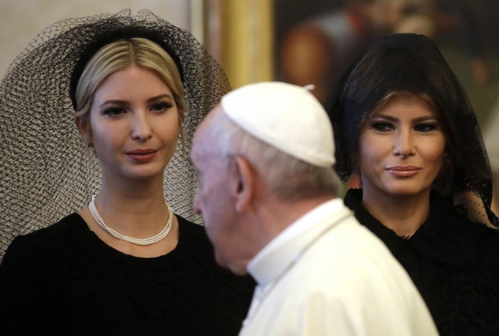 FILE - In this Wednesday, May 24, 2017 file photo Pope Francis walks past Ivanka Trump, left, and First Lady Melania Trump on the occasion of the priv...