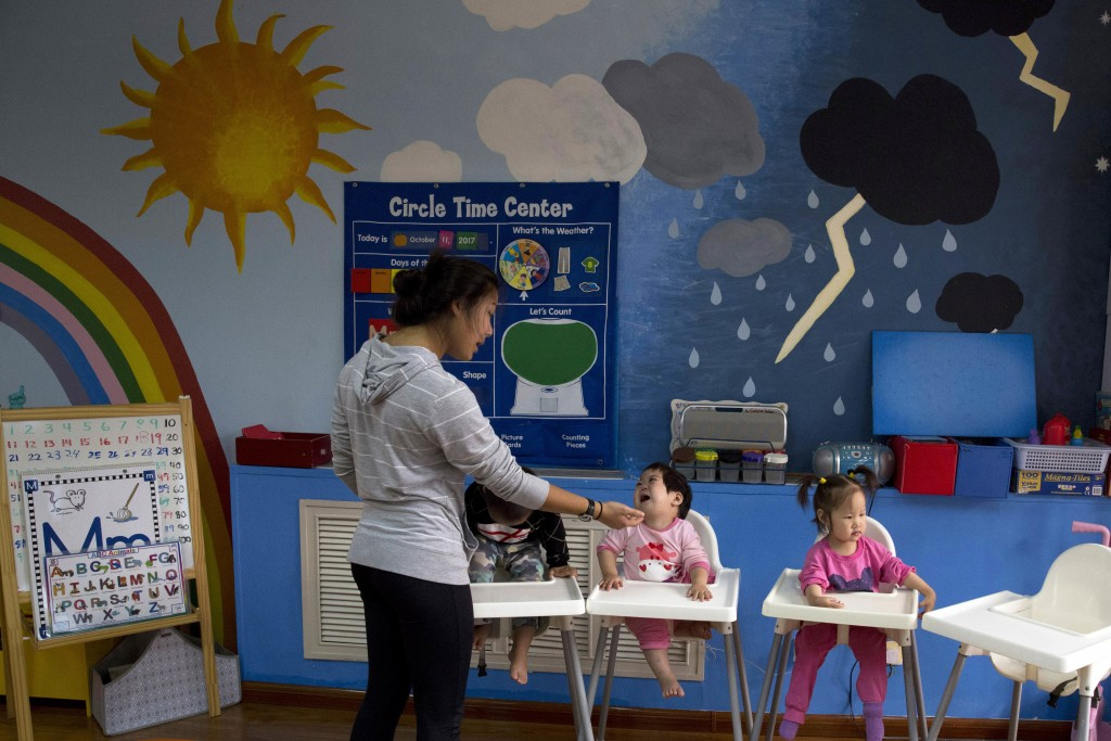 Children attend classes at a foster home of the New Hope Foundation on the outskirts of Beijing, China on Wednesday, Oct. 11, 2017. Following reports ...