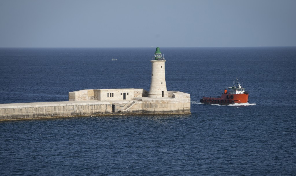 FILE - In this Feb. 3, 2017, file photo, a boat passes through the entrance to the Grand Harbour in Valletta, Malta. Valletta was declared one of two ...