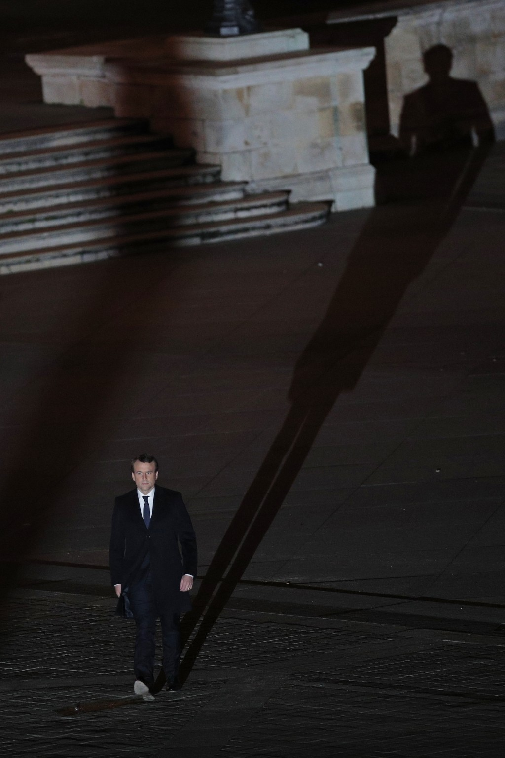 FILE - In this Sunday May 7, 2017 file photo incoming French President Emmanuel Macron walks towards the stage to address his supporters at the Louvre...
