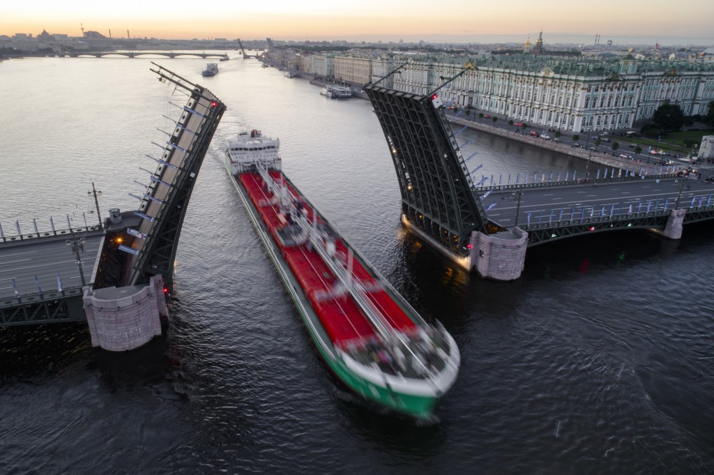 FILE - In this July 3, 2017, file photo, a tanker floats past the Dvortsovy drawbridge rising above the Neva River during White Nights in St. Petersbu...