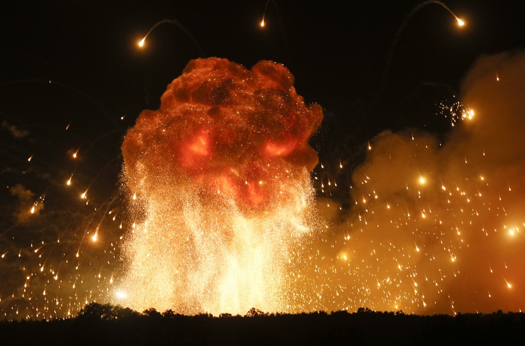 FILE - In this Wednesday, Sept. 27, 2017 file photo a powerful explosion is seen in the ammunition depot at a military base in Kalynivka, west of Kiev...