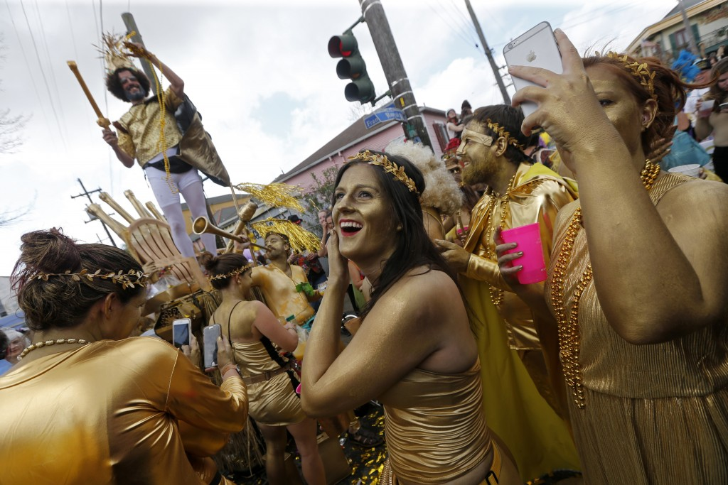 FILE - In this Feb. 28, 2017, file photo, revelers congregate at the start of the Society of Saint Anne Mardi Gras parade in New Orleans. The city cel...