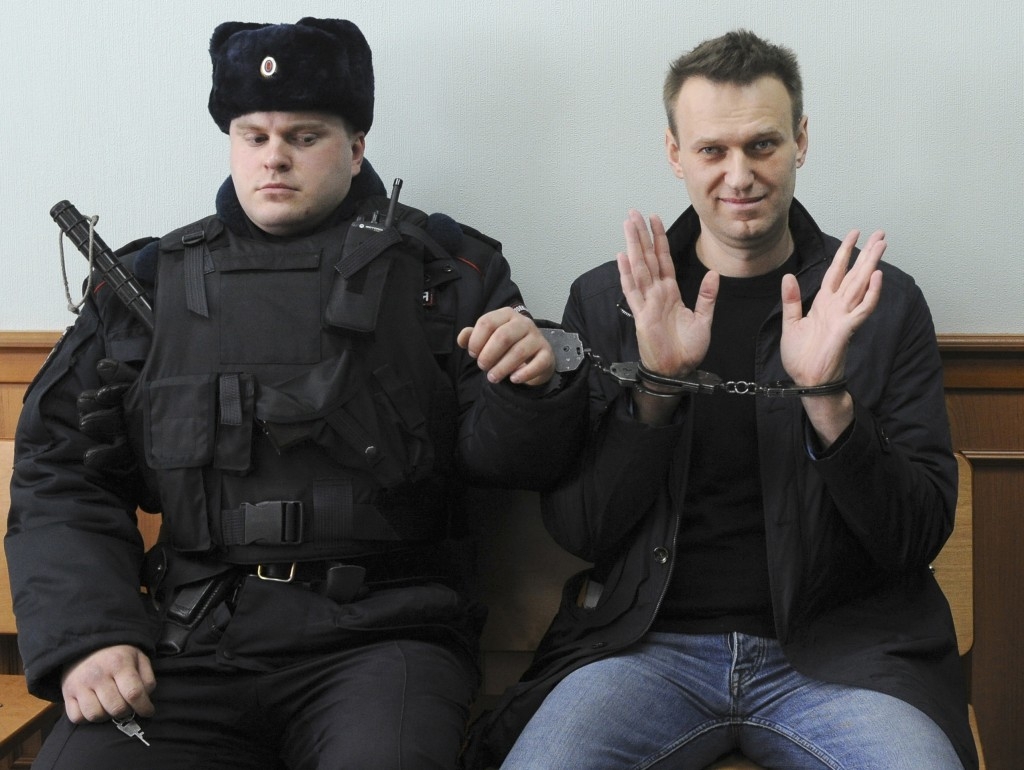 FILE - In this Thursday, March 30, 2017 file photo Russian opposition leader Alexei Navalny, right, poses for press in court in Moscow, Russia. Navaln...