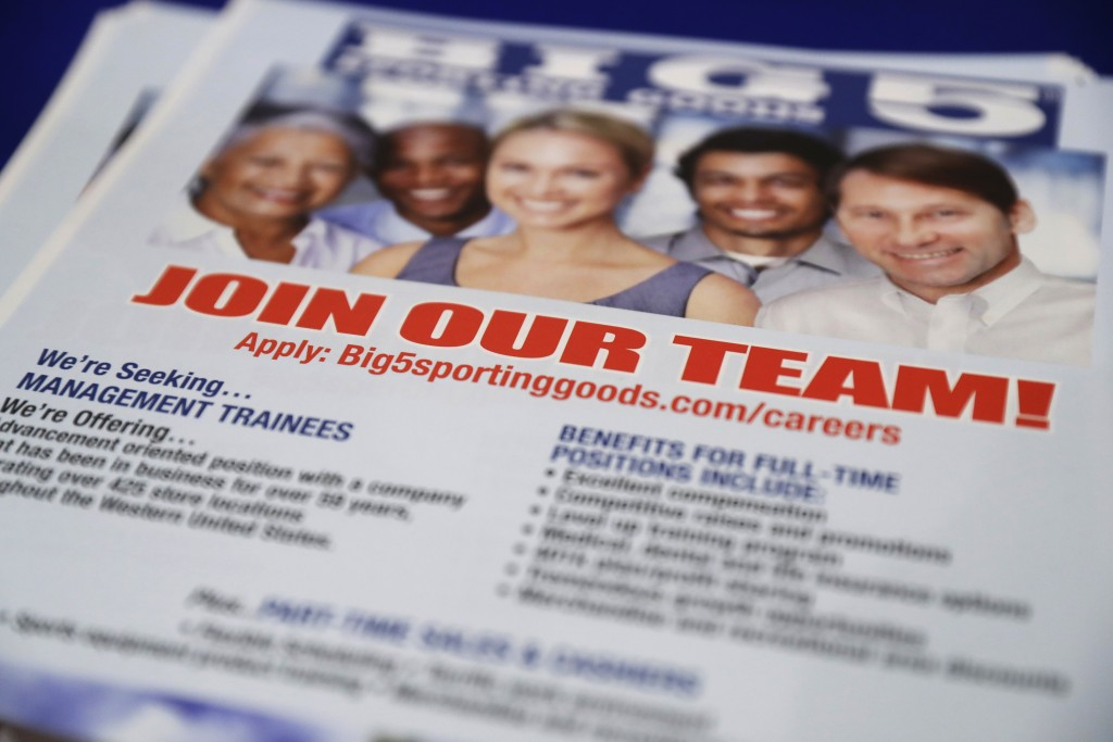 FILE - In this Thursday, Aug. 24, 2017, file photo, a flyer advertises job openings with Big 5 Sporting Goods during a job fair in San Jose, Calif. Th...