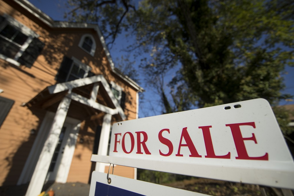 FILE - This Tuesday, Oct. 17, 2017, file photo shows a home for sale in Fort Washington, Pa. 2017's turbulent politics, natural disasters and more sho...