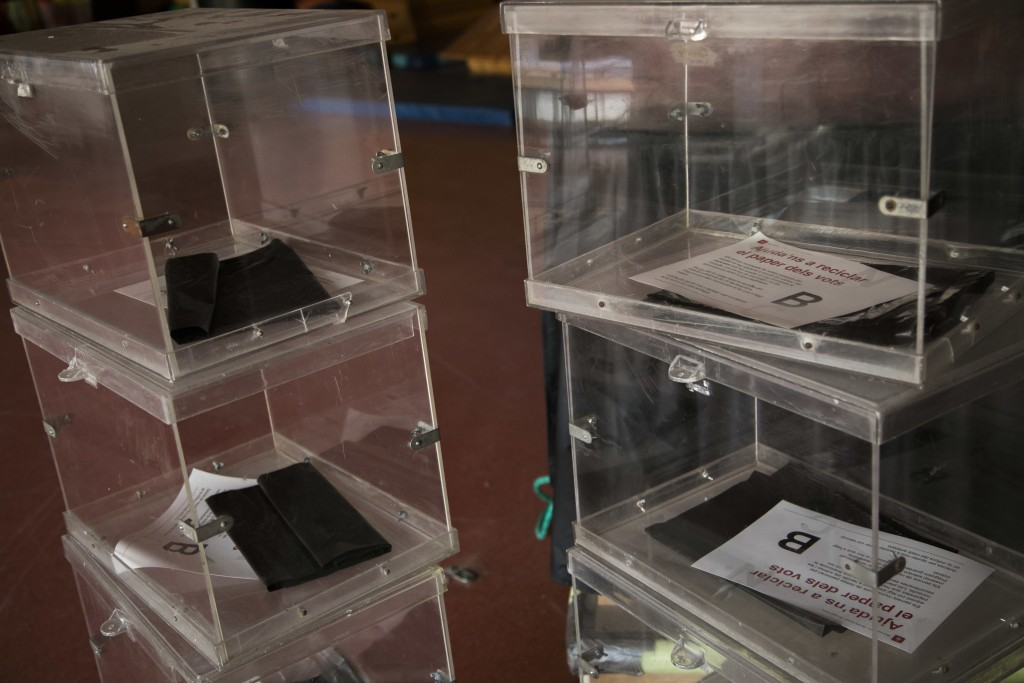 Ballot boxes stacked up inside the multipurpose room of a school, before been set up as a polling station, ahead of the Catalonia voting in Barcelona,...