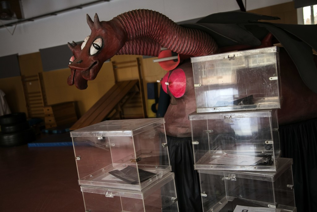 Ballot boxes piled up inside the multipurpose room of a school, before been set up as a polling station, ahead of the Catalonia voting in Barcelona, S...