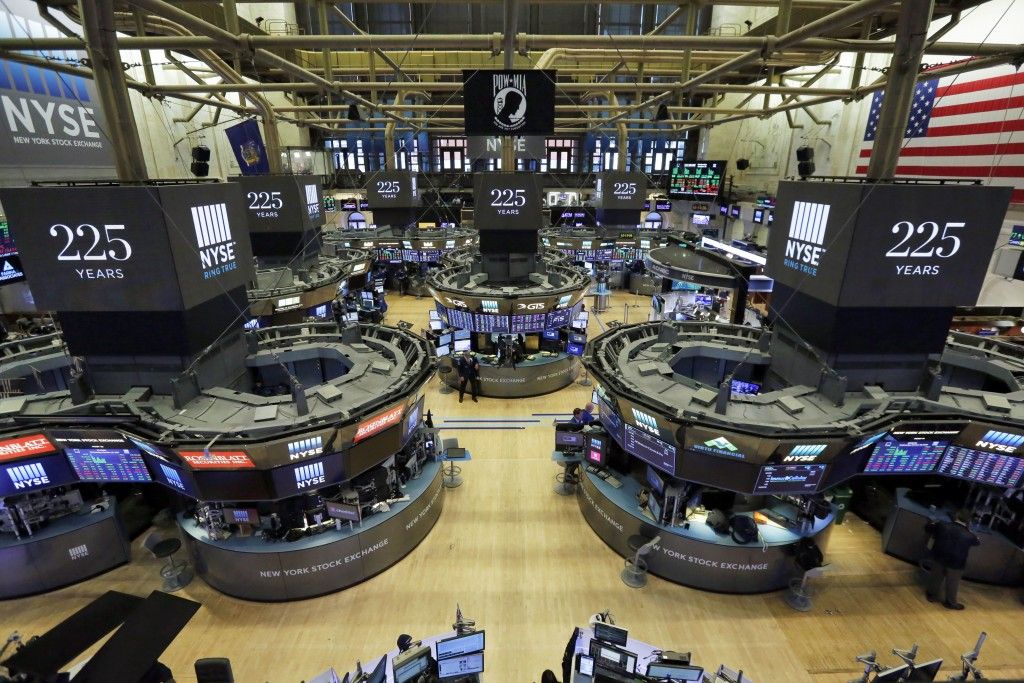 FILE - In this Wednesday, Oct. 18, 2017, file photo, traders work on the floor of the New York Stock Exchange. Wall Street is forecasting another year...