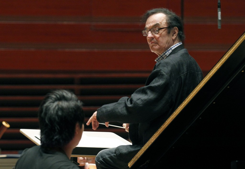 FILE- In this Oct. 19, 2011 file photo, world-renowned conductor Charles Dutoit, right, performs with the Philadelphia Orchestra during a rehearsal in...