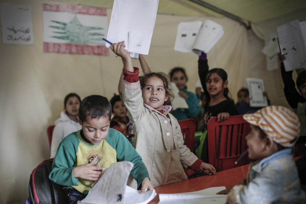 In this Dec. 1, 2014 photo provided by Sam Tarling and The John D. and Catherine T. MacArthur Foundation, young refugees from Syria appear in an educa...