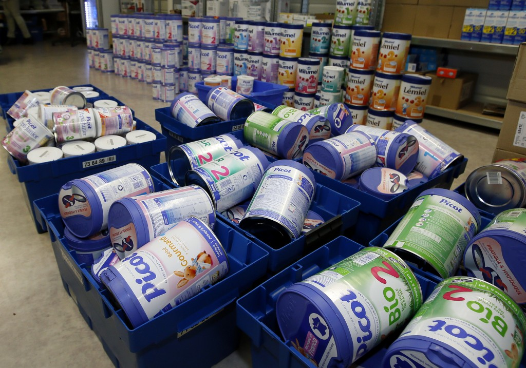 FILE - This Monday, Dec.11, 2017 file picture shows removed baby milk boxes pictured in a drugstore, in Anglet, southwestern France. A tainted baby mi...